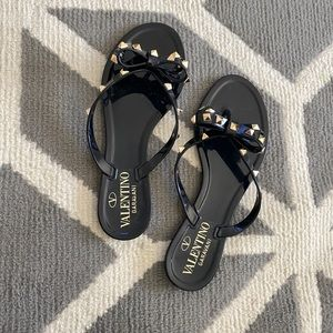 Black pair of valentino Jelly studded sandals